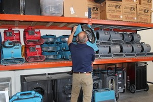 Water Damage Bluffdale Restoration Technician Prepping Air Movers
