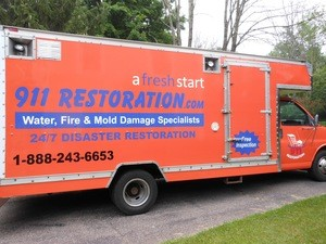 Water Damage Restoration Box Truck Parked At Residential Job Location