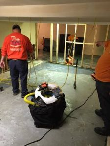 Water Damage Bluffdale Restoration Technicians Cleaning Carpet After A Flood