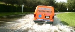 Water Damage West Valley City Van Driving Down Flooded Street