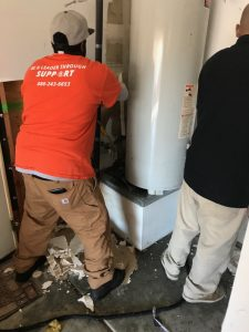 Technicians Repairing A Broken Water Heater