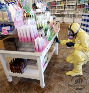 Technician cleaning retail store